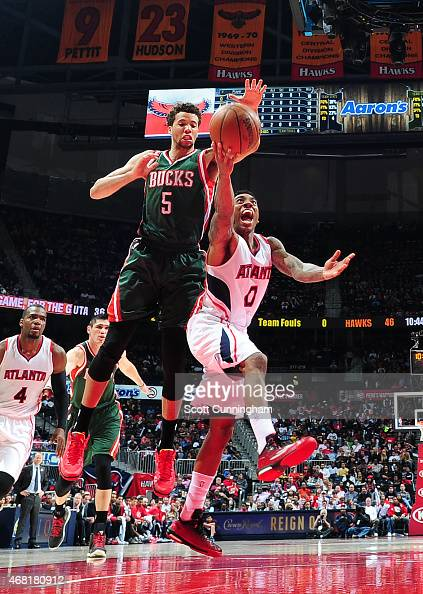 Jeff Teague of the Atlanta Hawks goes for the layup against the Milwaukee Bucks during the game on March 30 2015 at Philips Arena in Atlanta Georgia...