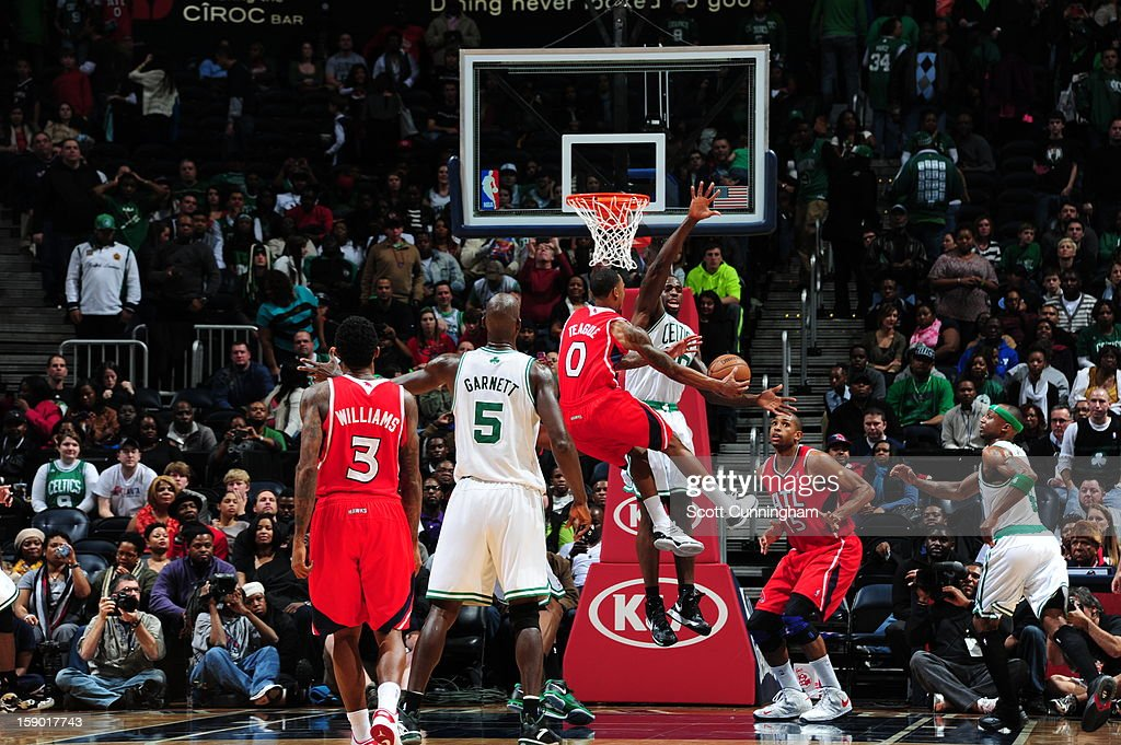 <a gi-track='captionPersonalityLinkClicked' href=/galleries/search?phrase=Jeff+Teague&family=editorial&specificpeople=4680498 ng-click='$event.stopPropagation()'>Jeff Teague</a> #0 of the Atlanta Hawks goes to the basket against <a gi-track='captionPersonalityLinkClicked' href=/galleries/search?phrase=Brandon+Bass&family=editorial&specificpeople=233806 ng-click='$event.stopPropagation()'>Brandon Bass</a> #30 of the Boston Celtics on January 5, 2013 at Philips Arena in Atlanta, Georgia.