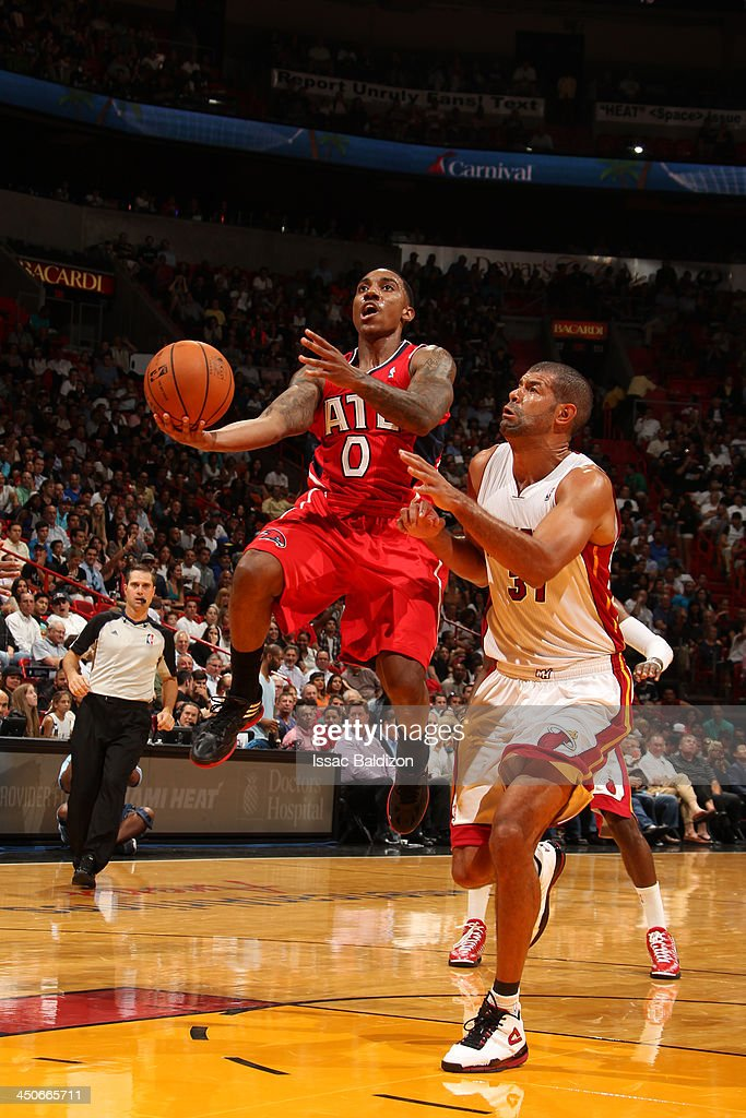<a gi-track='captionPersonalityLinkClicked' href=/galleries/search?phrase=Jeff+Teague&family=editorial&specificpeople=4680498 ng-click='$event.stopPropagation()'>Jeff Teague</a> #0 of the Atlanta Hawks goes to the basket against <a gi-track='captionPersonalityLinkClicked' href=/galleries/search?phrase=Shane+Battier&family=editorial&specificpeople=201814 ng-click='$event.stopPropagation()'>Shane Battier</a> #31 of the Miami Heat on November 19, 2013 at American Airlines Arena in Miami, Florida.