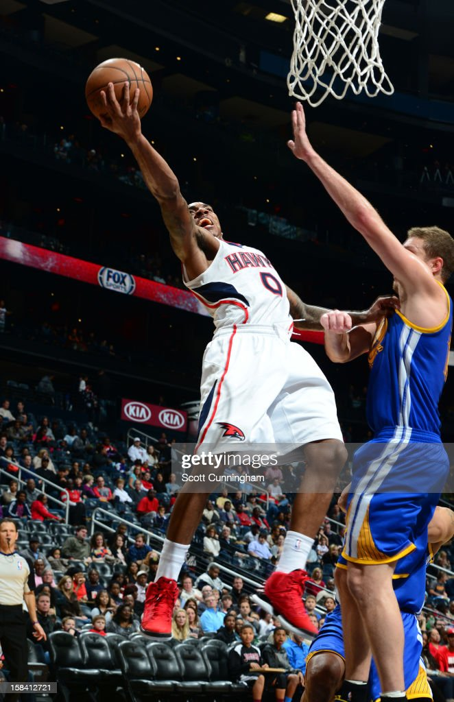 <a gi-track='captionPersonalityLinkClicked' href=/galleries/search?phrase=Jeff+Teague&family=editorial&specificpeople=4680498 ng-click='$event.stopPropagation()'>Jeff Teague</a> #0 of the Atlanta Hawks goes up for an off balence shot against the Golden State Warriors at SunTrust Center on December 15 ,2012 in Atlanta, Georgia.