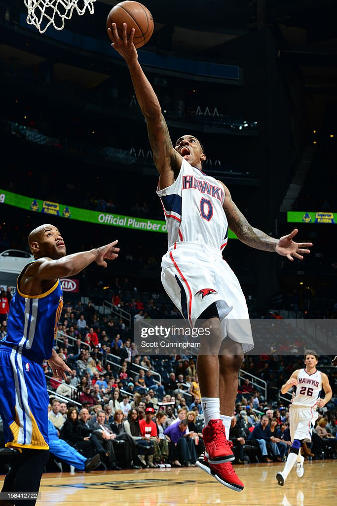 <a gi-track='captionPersonalityLinkClicked' href=/galleries/search?phrase=Jeff+Teague&family=editorial&specificpeople=4680498 ng-click='$event.stopPropagation()'>Jeff Teague</a> #0 of the Atlanta Hawks goes up for the easy layup against the Golden State Warriors at SunTrust Center on December 15 ,2012 in Atlanta, Georgia.