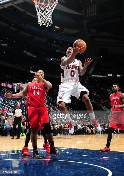 Jeff Teague of the Atlanta Hawks goes up for the layup against the Toronto Raptors on March 18 2014 at Philips Arena in Atlanta Georgia NOTE TO USER...