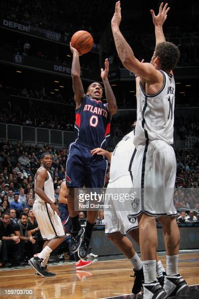 Jeff Teague of the Atlanta Hawks goes up for the shot against Brook Lopez of the Brooklyn Nets at the Barclays Center on January 18 2013 in the...