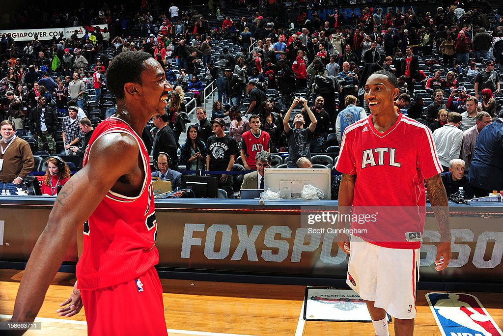 Jeff Teague #0 of the Atlanta Hawks greets his brother Marquis Teague #25 of the Chicago Bulls following their game on December 22, 2012 at Philips Arena in Atlanta, Georgia.