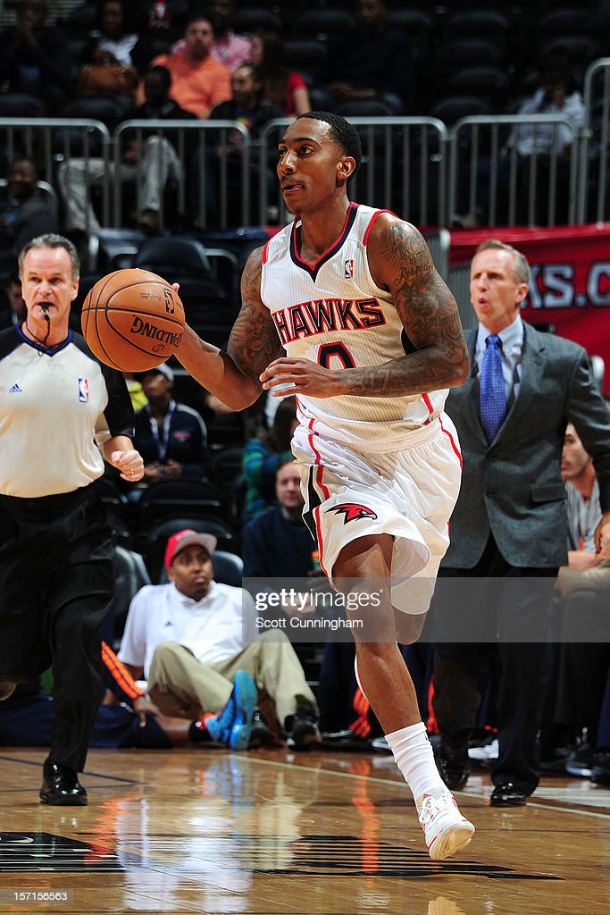<a gi-track='captionPersonalityLinkClicked' href=/galleries/search?phrase=Jeff+Teague&family=editorial&specificpeople=4680498 ng-click='$event.stopPropagation()'>Jeff Teague</a> #0 of the Atlanta Hawks handles the ball against the Charlotte Bobcats at Philips Arena on November 28, 2012 in Atlanta, Georgia.