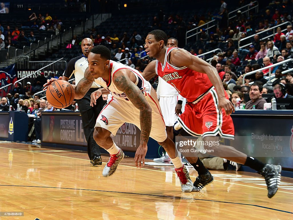 Jeff Teague #0 of the Atlanta Hawks handles the ball against the Milwaukee Bucks on March 13, 2014 at Philips Arena in Atlanta, Georgia.
