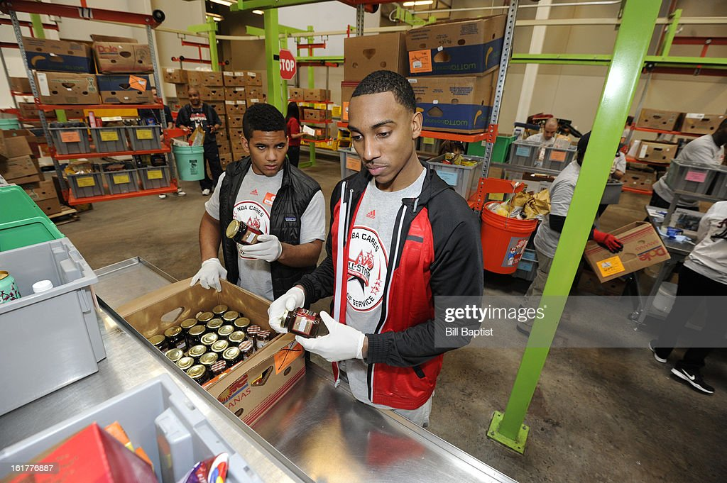 Jeff Teague #0 of the Atlanta Hawks helps package food at the 2013 NBA Cares Day of Service at the Food Bank sorting on February 15, 2013 in Houston, Texas.