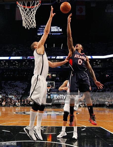 Jeff Teague of the Atlanta Hawks in action against Brook Lopez of the Brooklyn Nets during game four in the first round of the 2015 NBA Playoffs at...