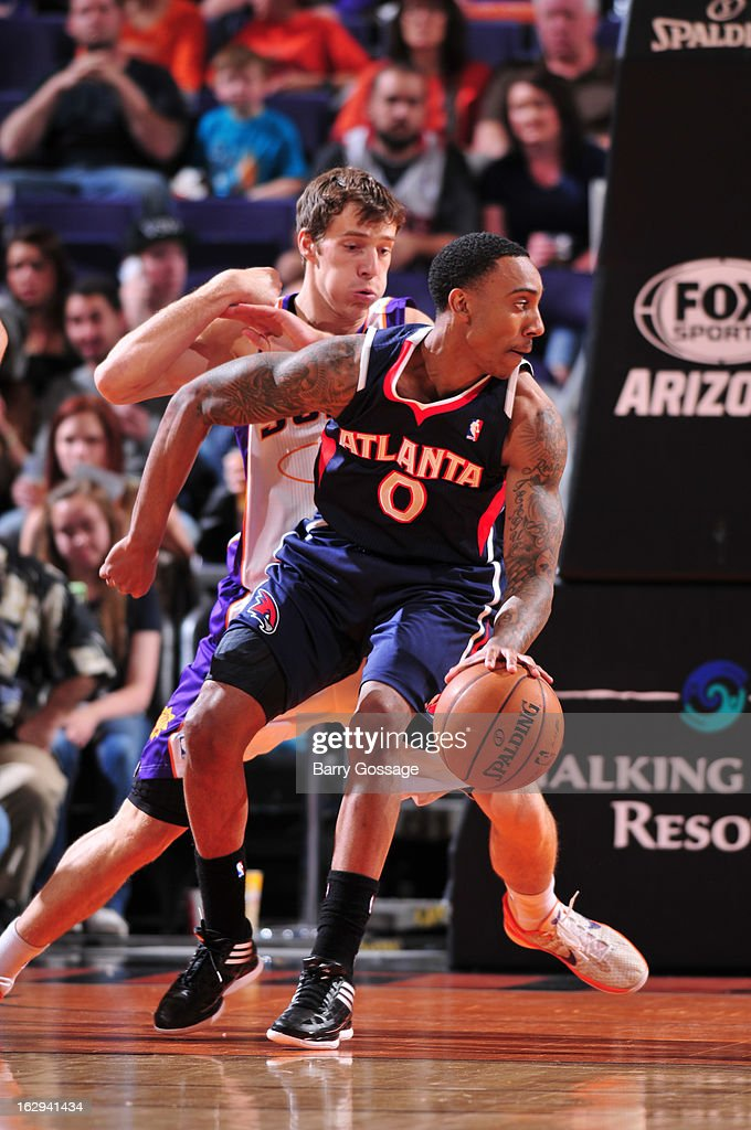 Jeff Teague #0 of the Atlanta Hawks is guarded by Goran Dragic #1 of the Phoenix Suns on March 1, 2013 at U.S. Airways Center in Phoenix, Arizona.