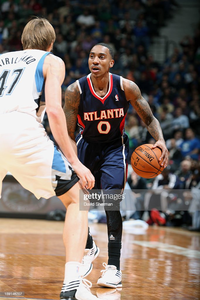 Jeff Teague #0 of the Atlanta Hawks looks to go up against Andrei Kirilenko #47 of the Minnesota Timberwolves during the game on January 8, 2013 at Target Center in Minneapolis, Minnesota.