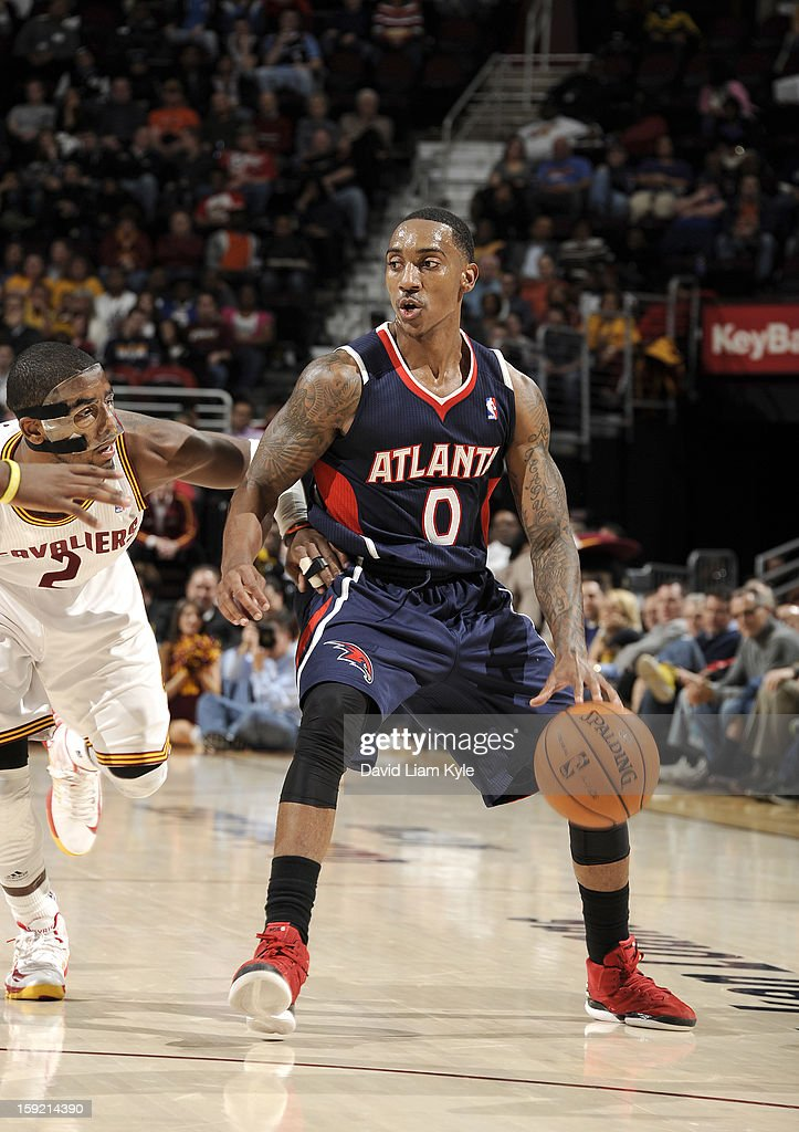 Jeff Teague #0 of the Atlanta Hawks looks to make his move against Kyrie Irving #2 of the Cleveland Cavaliers at The Quicken Loans Arena on January 9, 2013 in Cleveland, Ohio.