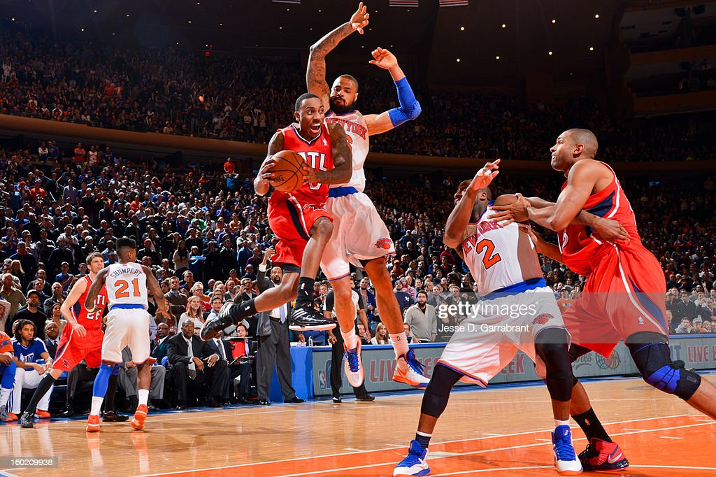 Jeff Teague #0 of the Atlanta Hawks looks to pass the ball in the lane against Tyson Chandler #6 of the New York Knicks as time runs out in the fourth quarter of their game at Madison Square Garden on January 27, 2013 in New York, New York.