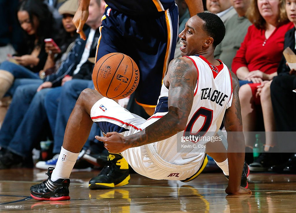 <a gi-track='captionPersonalityLinkClicked' href=/galleries/search?phrase=Jeff+Teague&family=editorial&specificpeople=4680498 ng-click='$event.stopPropagation()'>Jeff Teague</a> #0 of the Atlanta Hawks loses the ball as he dribbles into <a gi-track='captionPersonalityLinkClicked' href=/galleries/search?phrase=Luis+Scola&family=editorial&specificpeople=2464749 ng-click='$event.stopPropagation()'>Luis Scola</a> #4 of the Indiana Pacers at Philips Arena on October 22, 2013 in Atlanta, Georgia.