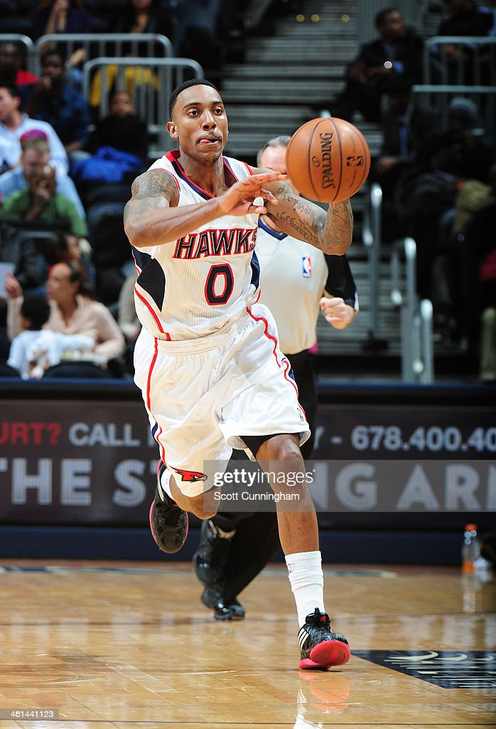 <a gi-track='captionPersonalityLinkClicked' href=/galleries/search?phrase=Jeff+Teague&family=editorial&specificpeople=4680498 ng-click='$event.stopPropagation()'>Jeff Teague</a> #0 of the Atlanta Hawks passing the ball during a game against the Indiana Pacers of the Atlanta Hawks against of the Indiana Pacers on January 8, 2014 at Philips Arena in Atlanta, Georgia.