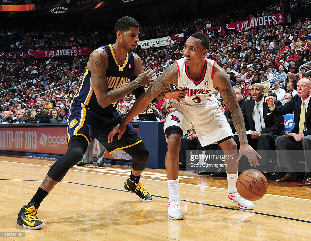 Jeff Teague #0 of the Atlanta Hawks protects the ball from Paul George #24 of the Indiana Pacers during the Game Three of the Eastern Conference Quarterfinals between the Indiana Pacers and the Atlanta Hawks in the 2013 NBA Playoffs on April 27, 2013 at Philips Arena in Atlanta, Georgia.