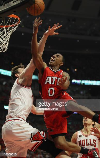 Jeff Teague of the Atlanta Hawks puts up a shot against Omer Asik of the Chicago Bulls in Game Five of the Eastern Conference Semifinals in the 2011...