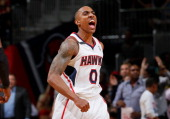 Jeff Teague of the Atlanta Hawks reacts after a dunk against the Indiana Pacers in Game 3 of the Eastern Conference Quarterfinals during the 2014 NBA...