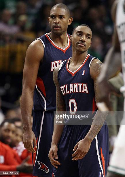 Jeff Teague of the Atlanta Hawks reacts after he is called for a technical foul as teammate Al Horford consoles him in Game Six of the Eastern...