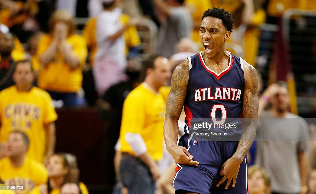 Jeff Teague of the Atlanta Hawks reacts in overtime against the Cleveland Cavaliers during Game Three of the Eastern Conference Finals of the 2015...