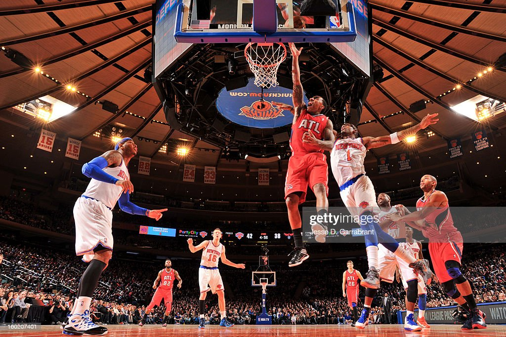 Jeff Teague #0 of the Atlanta Hawks shoots a layup against Amar'e Stoudemire #1 of the New York Knicks at Madison Square Garden on January 27, 2013 in New York, New York.