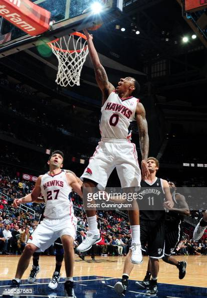 Jeff Teague of the Atlanta Hawks shoots a layup against the Brooklyn Nets on January 16 2013 at Philips Arena in Atlanta Georgia NOTE TO USER User...