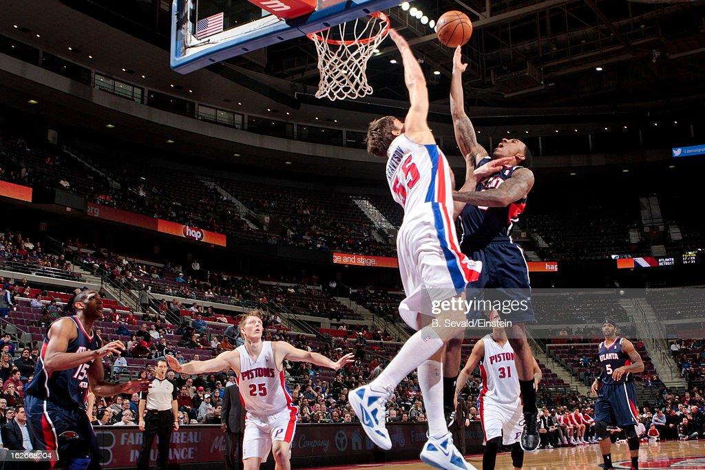 Jeff Teague #0 of the Atlanta Hawks shoots a layup against Viacheslav Kravtsov #55 of the Detroit Pistons on February 25, 2013 at The Palace of Auburn Hills in Auburn Hills, Michigan.