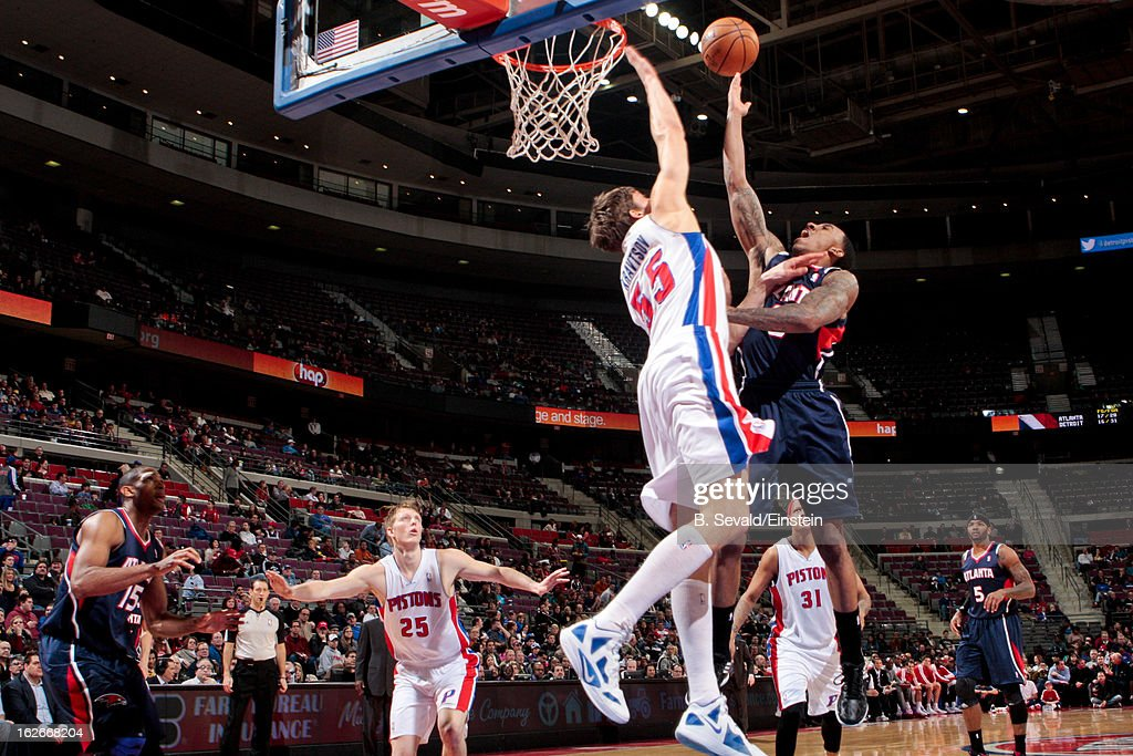 Jeff Teague of the Atlanta Hawks shoots a layup against Viacheslav Kravtsov of the Detroit Pistons on February 25 2013 at The Palace of Auburn Hills...