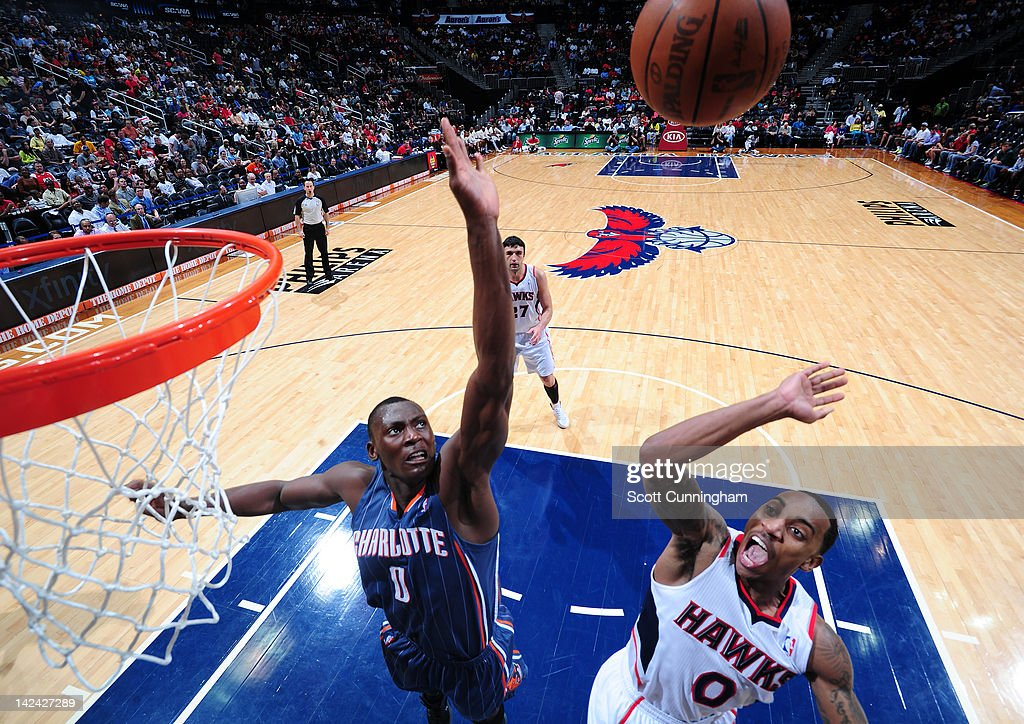 <a gi-track='captionPersonalityLinkClicked' href=/galleries/search?phrase=Jeff+Teague&family=editorial&specificpeople=4680498 ng-click='$event.stopPropagation()'>Jeff Teague</a> #0 of the Atlanta Hawks shoots against <a gi-track='captionPersonalityLinkClicked' href=/galleries/search?phrase=Bismack+Biyombo&family=editorial&specificpeople=7640443 ng-click='$event.stopPropagation()'>Bismack Biyombo</a> #0 of the Charlotte Bobcats on April 4, 2012 at Philips Arena in Atlanta, Georgia.