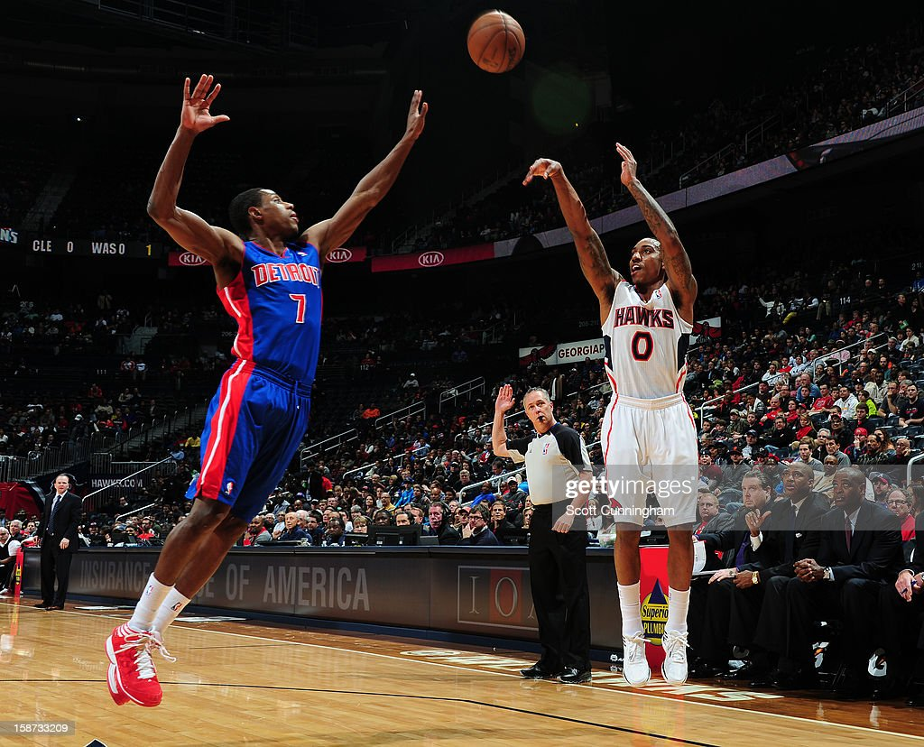 Jeff Teague #0 of the Atlanta Hawks shoots against Brandon Knight #7 of the Detroit Pistons on December 26, 2012 at Philips Arena in Atlanta, Georgia.