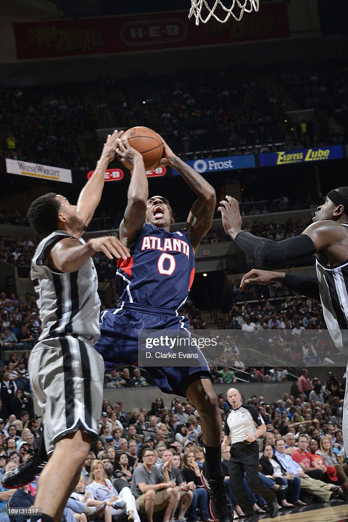 <a gi-track='captionPersonalityLinkClicked' href=/galleries/search?phrase=Jeff+Teague&family=editorial&specificpeople=4680498 ng-click='$event.stopPropagation()'>Jeff Teague</a> #0 of the Atlanta Hawks shoots against <a gi-track='captionPersonalityLinkClicked' href=/galleries/search?phrase=Cory+Joseph&family=editorial&specificpeople=5953537 ng-click='$event.stopPropagation()'>Cory Joseph</a> #5 of the San Antonio Spurs on April 6, 2013 at the AT&T Center in San Antonio, Texas.