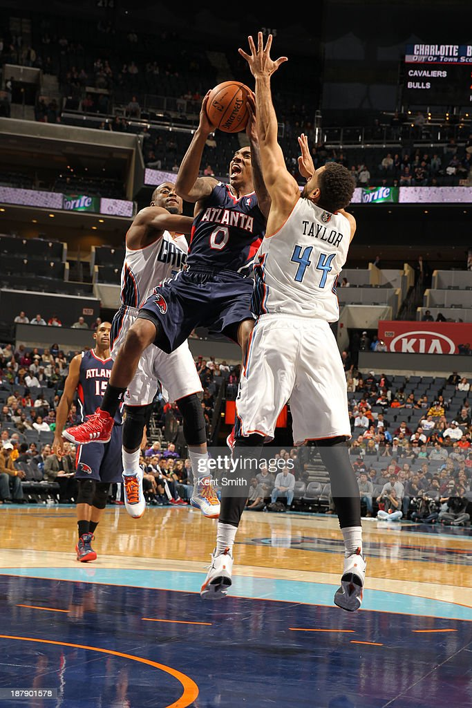 <a gi-track='captionPersonalityLinkClicked' href=/galleries/search?phrase=Jeff+Teague&family=editorial&specificpeople=4680498 ng-click='$event.stopPropagation()'>Jeff Teague</a> #0 of the Atlanta Hawks shoots against Jeffery Taylor #44 of the Charlotte Bobcats during the game at the Time Warner Cable Arena on November 11, 2013 in Charlotte, North Carolina.