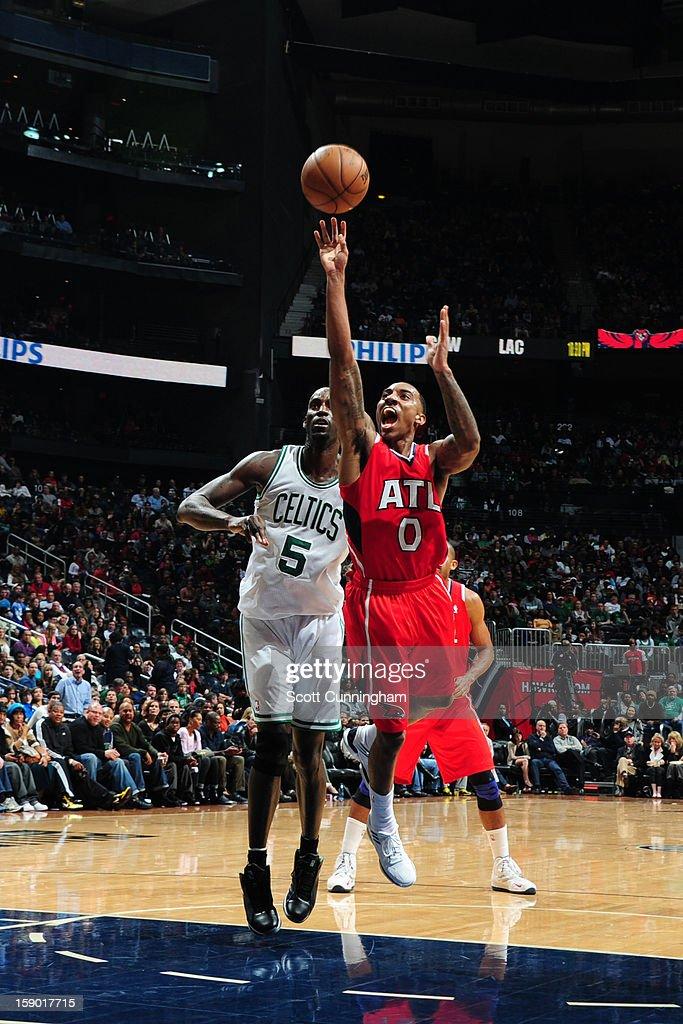 Jeff Teague #0 of the Atlanta Hawks shoots against Kevin Garnett #5 of the Boston Celtics on January 5, 2013 at Philips Arena in Atlanta, Georgia.