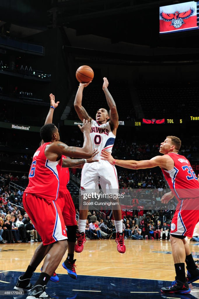 <a gi-track='captionPersonalityLinkClicked' href=/galleries/search?phrase=Jeff+Teague&family=editorial&specificpeople=4680498 ng-click='$event.stopPropagation()'>Jeff Teague</a> #0 of the Atlanta Hawks shoots against the Los Angeles Clippers on December 4, 2013 at Philips Arena in Atlanta, Georgia.