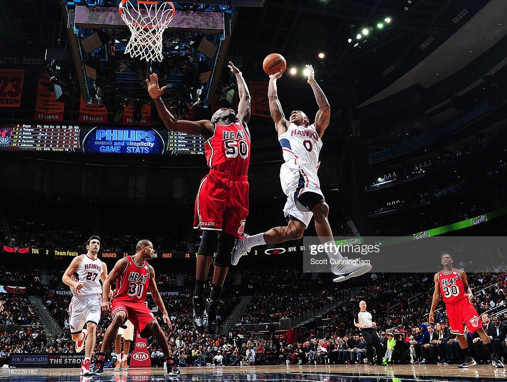 Jeff Teague #0 of the Atlanta Hawks shoots the ball against Joel Anthony #50 of the Miami Heat on February 20, 2013 at Philips Arena in Atlanta, Georgia.