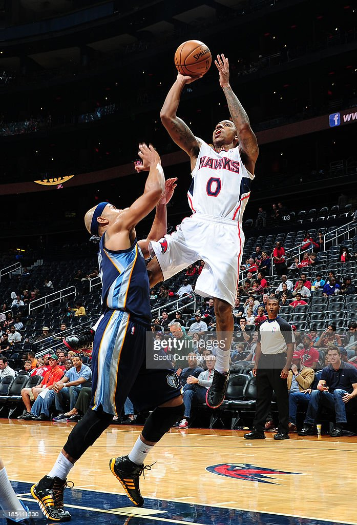 <a gi-track='captionPersonalityLinkClicked' href=/galleries/search?phrase=Jeff+Teague&family=editorial&specificpeople=4680498 ng-click='$event.stopPropagation()'>Jeff Teague</a> #0 of the Atlanta Hawks shoots the ball against the Memphis Grizzlies on October 20, 2013 at Philips Arena in Atlanta, Georgia.
