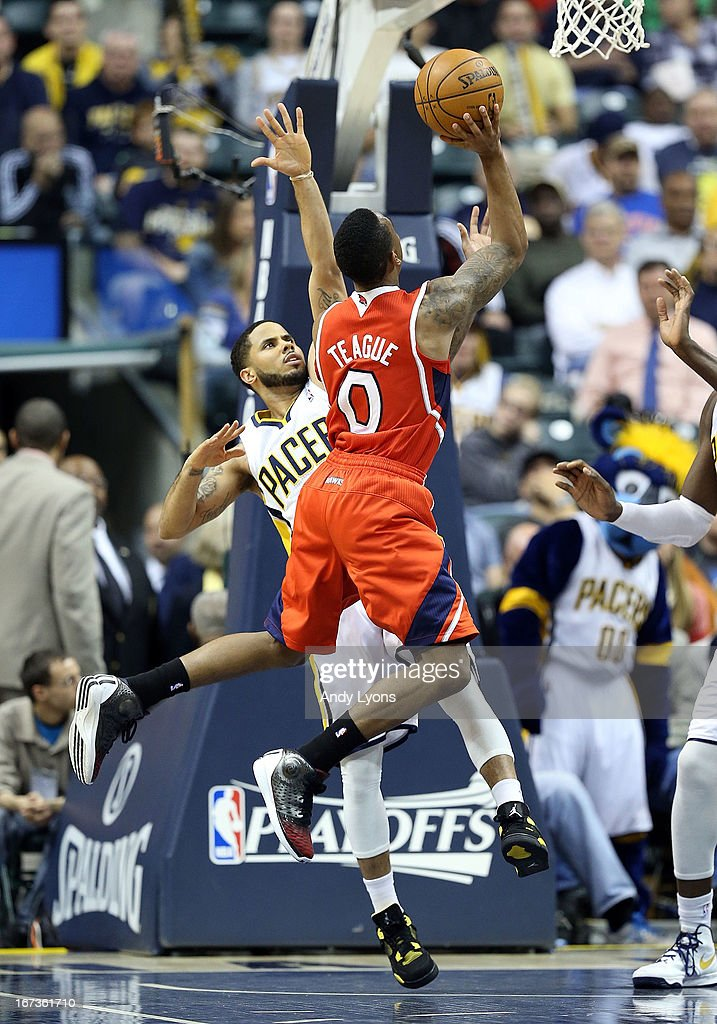 Jeff Teague #0 of the Atlanta Hawks shoots the ball while defended by D.J. Augustin #14 of the Indiana Pacers during Game Two of the Eastern Conference Quarterfinals of the 2013 NBA Playoffs at Bankers Life Fieldhouse on April 24, 2013 in Indianapolis, Indiana.