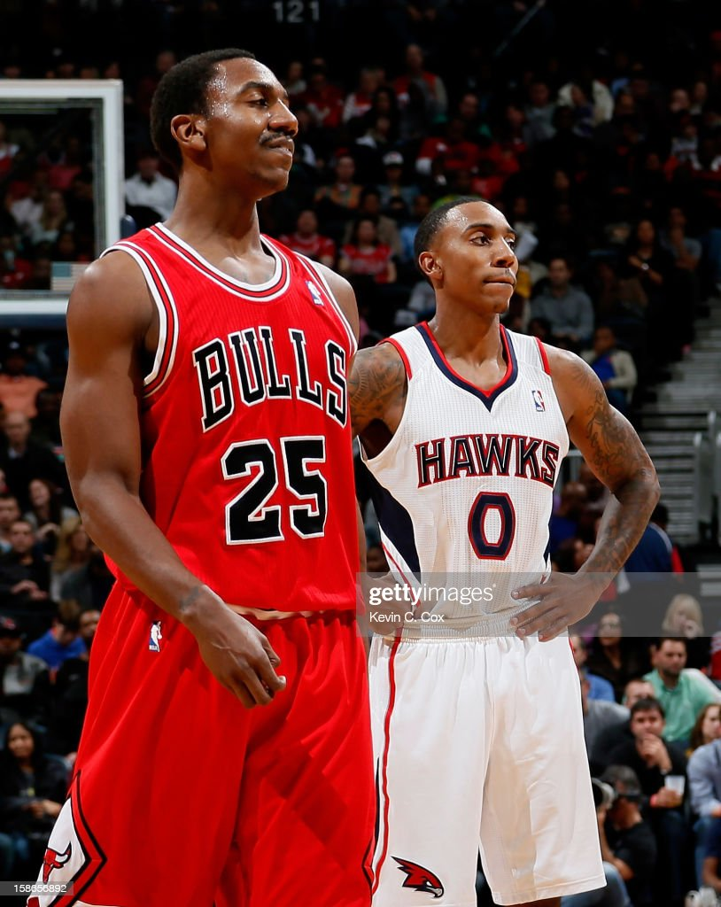 Jeff Teague #0 of the Atlanta Hawks stands behind Marquis Teague #25 of the Chicago Bulls at Philips Arena on December 22, 2012 in Atlanta, Georgia.