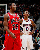 Jeff Teague of the Atlanta Hawks stands behind Marquis Teague of the Chicago Bulls at Philips Arena on December 22 2012 in Atlanta Georgia NOTE TO...