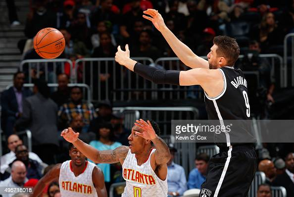 Jeff Teague of the Atlanta Hawks steals a pass from Andrea Bargnani of the Brooklyn Nets at Philips Arena on November 4 2015 in Atlanta Georgia NOTE...