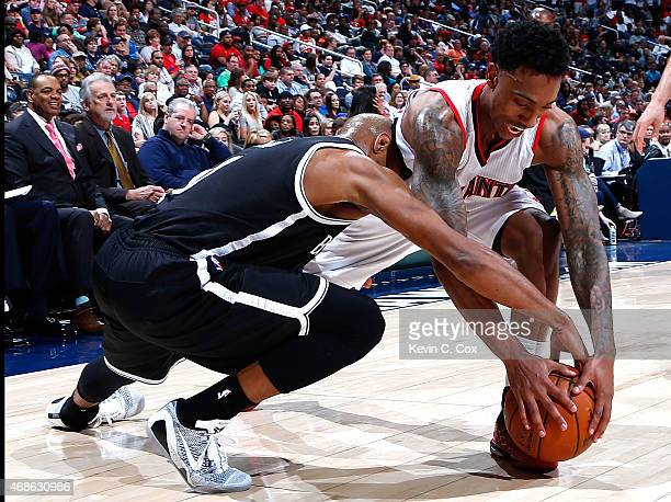 Jeff Teague of the Atlanta Hawks steals the ball from Jarrett Jack of the Brooklyn Nets at Philips Arena on April 4 2015 in Atlanta Georgia NOTE TO...