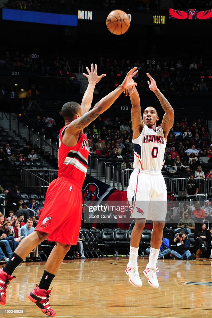 <a gi-track='captionPersonalityLinkClicked' href=/galleries/search?phrase=Jeff+Teague&family=editorial&specificpeople=4680498 ng-click='$event.stopPropagation()'>Jeff Teague</a> #0 of the Atlanta Hawks takes a shot against the Portland Trail Blazers on March 22, 2013 at Philips Arena in Atlanta, Georgia.
