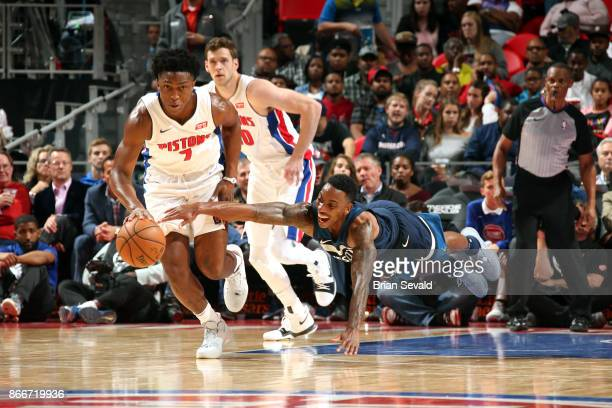 Jeff Teague of the Minnesota Timberwolves dives for the ball against Stanley Johnson of the Detroit Pistons on October 25 2017 at Little Caesars...