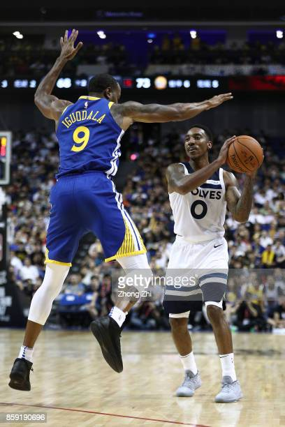 Jeff Teague of the Minnesota Timberwolves in action against Andre Iguodala of the Golden State Warriors during the game between the Minnesota...