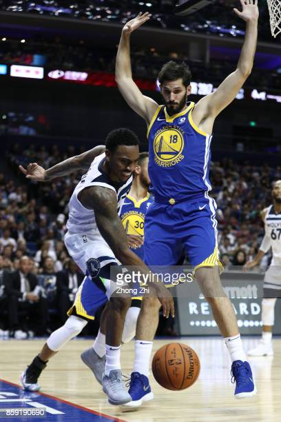 Jeff Teague of the Minnesota Timberwolves in action against Omri Casspi of the Golden State Warriors during the game between the Minnesota...