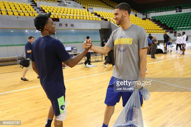 Jeff Teague of the Minnesota Timberwolves talks with Georges Niang of the Golden State Warriors during practice and media availability at Shenzhen...