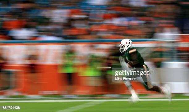 Jeff Thomas of the Miami Hurricanes returns a kick during a game against the Syracuse Orange at Sun Life Stadium on October 21 2017 in Miami Gardens...