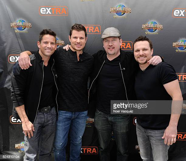Jeff Timmons Nick Lachey Justin Jeffre and Drew Lachey of 98 Degrees visit 'Extra' at Universal Studios Hollywood on April 25 2016 in Universal City...