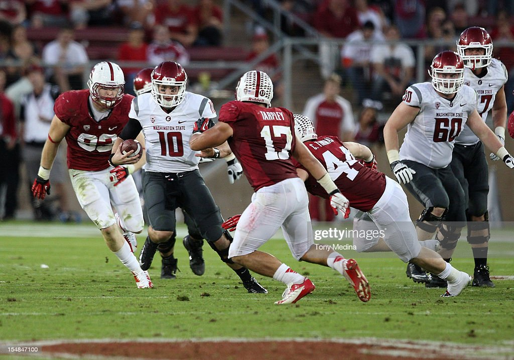 Jeff Tuel #10 of the Washington State Cougars scrambles but is surrounded by Charlie Hopkins #92 of the Stanford Cardinal, Chase Thomas #44 of the Stanford Cardinal, and A.J. Tarpley #17 of the Stanford Cardinal during the third quarter of play at Stanford Stadium on October 27, 2012 in Palo Alto, California.