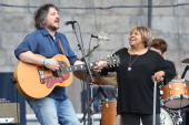 Jeff Tweedy and Mavis Staples perform during the 2014 Newport Folk Festival at Fort Adams State Park on July 27 2014 in Newport Rhode Island