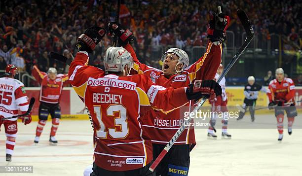 Jeff Ulmer of Duesseldorf celebrates after scoring his teams first goal during the DEL match between DEG Metro Stars and Koelner Haie at ISS Dome on...